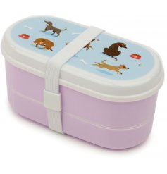 a purple toned bento box with added matching cutlery and a quirky dog print