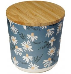 A stylish storage solution for any kitchen space, a sturdy bamboo based container with a wood lid and cute daisy decal