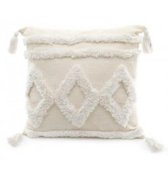 A texture covered square cushion complete with tasseled edges and a sleek off white colouring