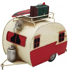 A vintage inspired decorative Caravan with a realistic finish and red tone to complete
