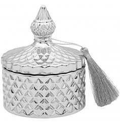 a sleek silver toned diamond ridge candle holder complete with vintage accents and a fuzzy tassel