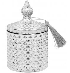 , a sleek silver toned diamond ridge candle holder complete with vintage accents and a fuzzy tassel