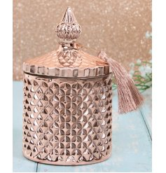 a sleek rose gold toned diamond ridge candle holder complete with vintage accents and a fuzzy tassel