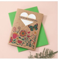 A small A7 sized greetings card decorated with a sweet floral print and complete with a paper heart filled with wildflo