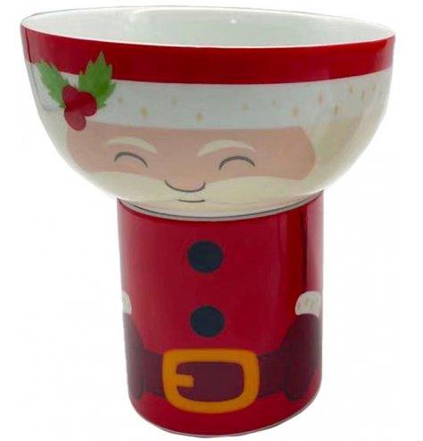 A red and white santa bowl and mug set with a Christmas charm