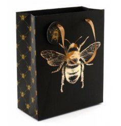 A medium gift bag with black and gold tones, decorated with a luxe Bee central decal