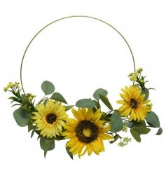 Sure to hang perfectly on any front door throughout the entire year, a half decorated ring wreath set with a bright sunf