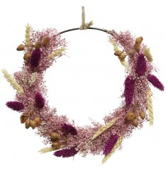 A stunning rustic wreath made from an abundance of dried flowers wrapped around a ring wreath.