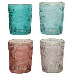 Four coloured glass T-Light or votive holders with a golden finish on the edge.