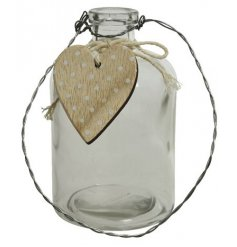 A clear glass bottle vase with wooden heart for decoration.