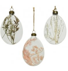 Three assorted glass eggs with dried flowers on a natural rope hanger.