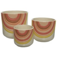 A Set of Three Terracotta Planters in Quirky Rainbow Design
