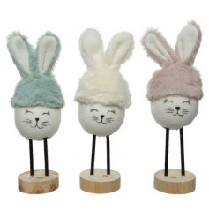 An Assortment of Three Polyester Bunnies with Iron Feet, in Pastel Colours