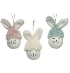 An Assortment of Three Polyester Hanging Bunnies
