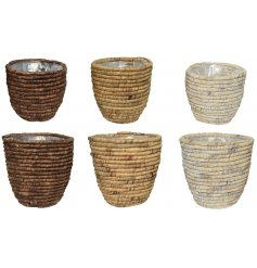 A mix of 3 fully lined planters, each with a natural woven design.