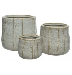 A Set of Three round Stoneware Planters in a Stripe Design