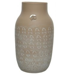 A terracotta vase with an unusual pattern to provide an illusion to vase.