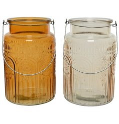 Two assorted glasses with iron handles with a curl pattern as decor on the glass.