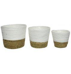 A set of 3 round natural grass baskets.