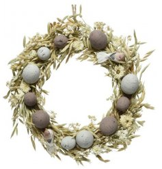 A whimsical wreath, decorated with seasonal grasses, flowers and an added touch of eggs!