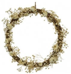 Round wreath with delicate flowers and grasses. Wreath is held with a jute hanger.