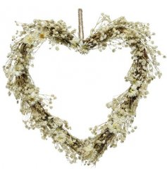 Heart shaped wreath with delicate flowers and grasses.