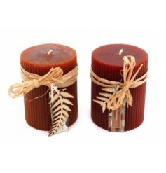 An Assortment of Two Ribbed Pillar Candles, in Maroon Red and Burnt Orange