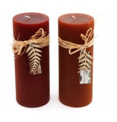 An assortment of two Ribbed Pilar candles, in Maroon Red and Burnt Orange