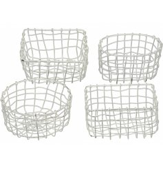 A mix of 4 rustic white metal baskets. Chic storage baskets which can be used for a variety of items