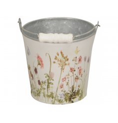 A pretty bucket with carry handle. Decorated with a colourful meadow of wild flowers.
