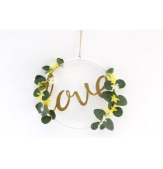 A beautiful and botanical wreath with gold love slogan.