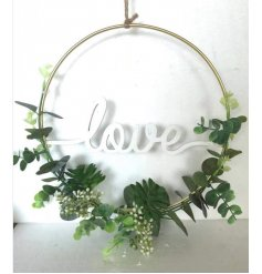 A Gold Decorative Hoop with Love Wording