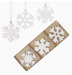 A Charming White Wooden Snowflake Set