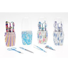 Scissors, Nail file, Clippers and Tweezers. Floral pattern